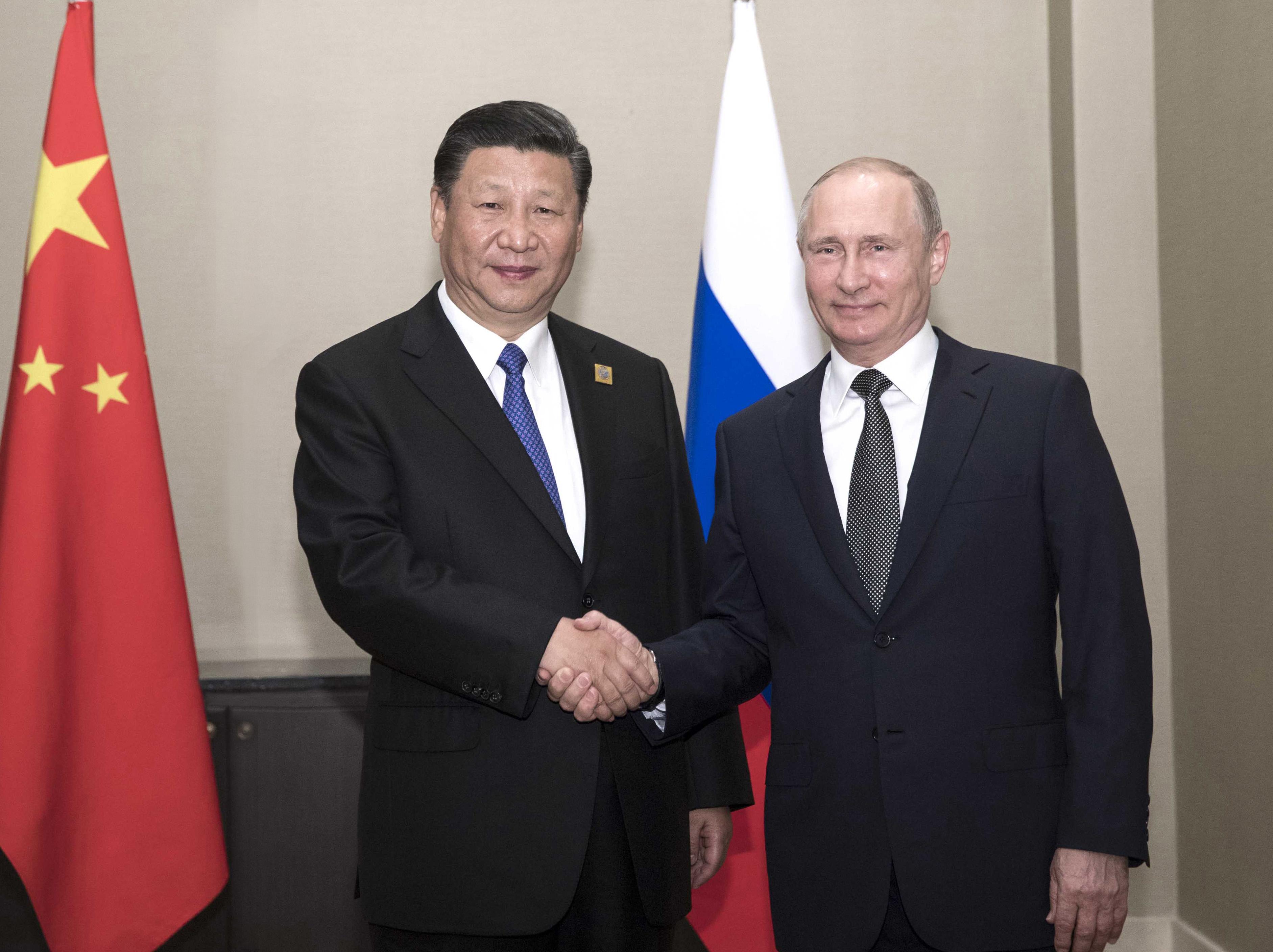 Xi, Putin meet on bilateral ties, SCO development
