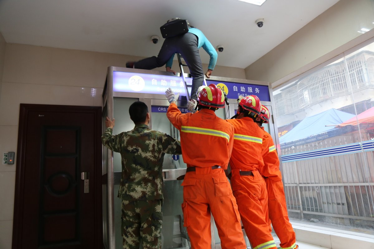 Two women need ladder to get out after getting stuck inside ATM cabin