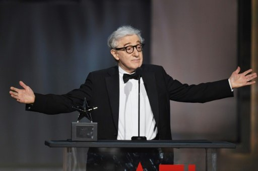 Topless protesters disrupt Woody Allen concert in Germany