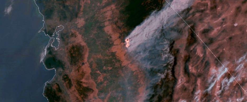 Crews stop spread of huge California wildfire near Yosemite