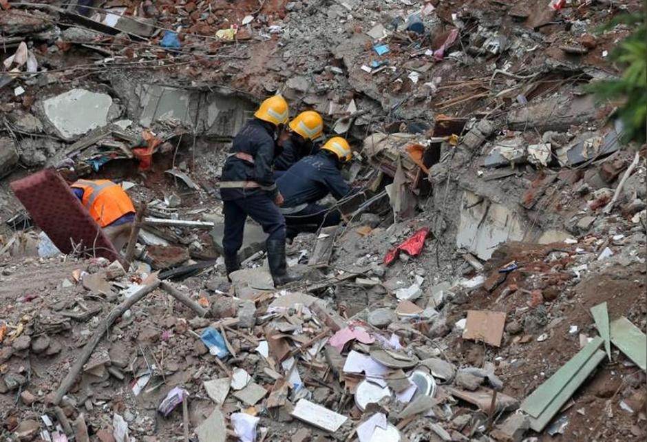 Indian police make arrest after building collapse kills 17