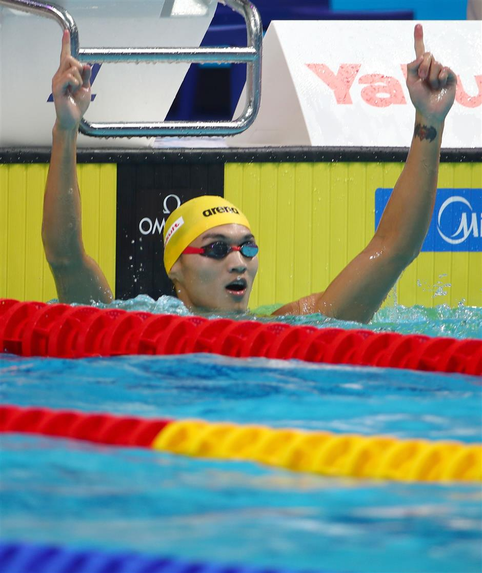 Xu wins 100 backstroke title as 3 records fall