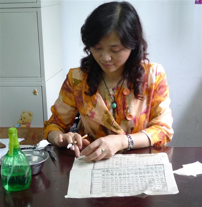 Restorer's craft nurtures ancient parchments back to life