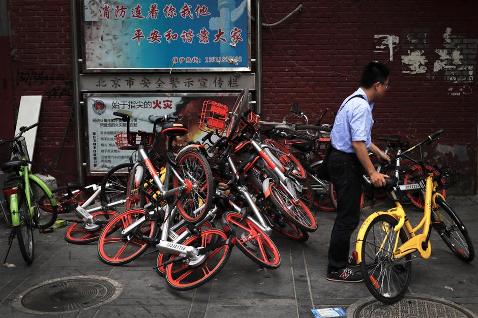 New guidelines aim to stem the flood of shared bikes on China's city streets