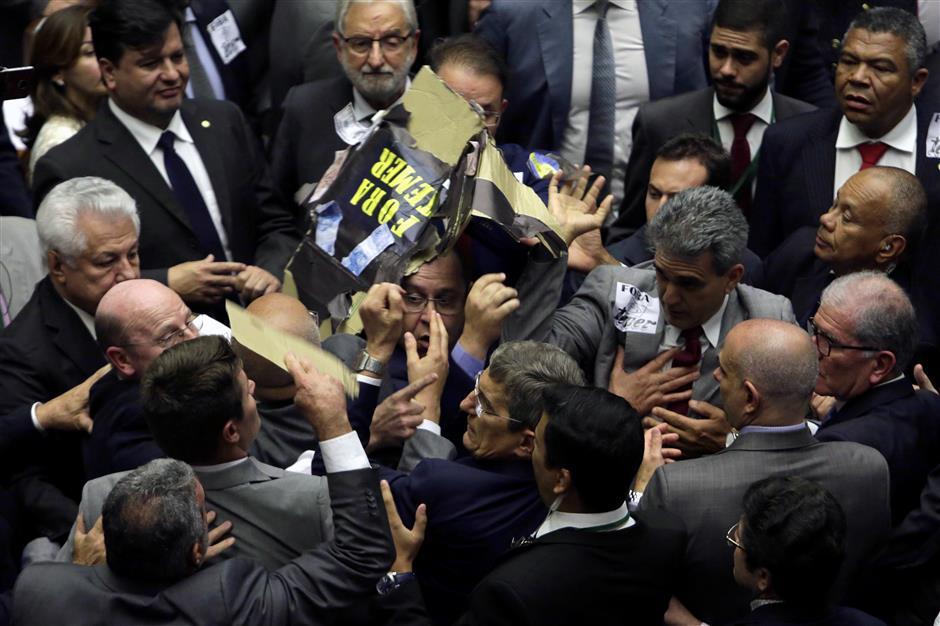 Brazil's Temer defeats corruption rap, pushes reforms