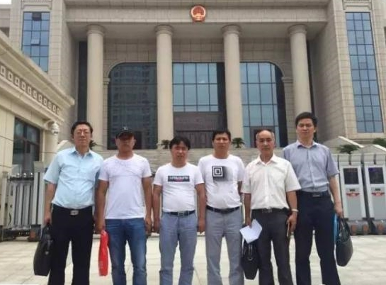 Four acquitted Chinese men get millions of state compensation