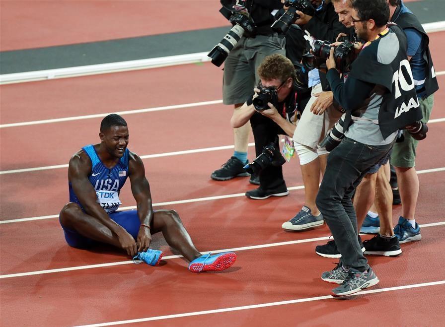 Gatlin stuns Bolt for 100m title