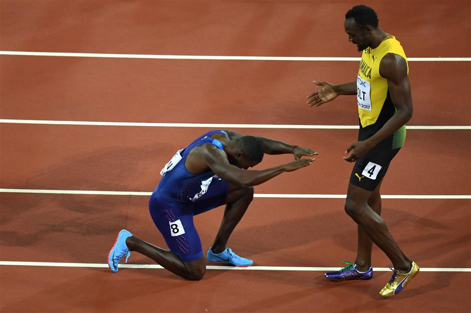 Gatlin takes gold, pays respect to Bolt at worlds