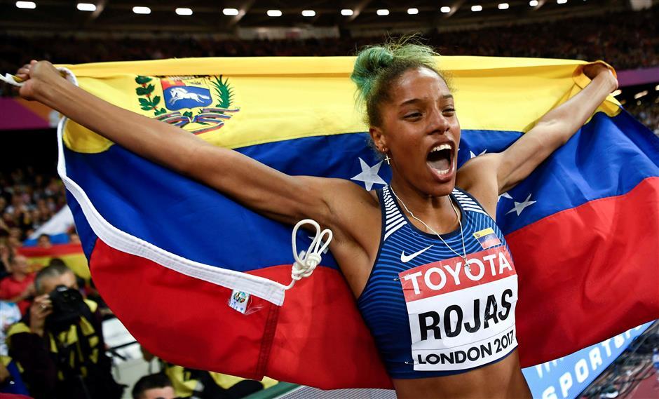 Rojas wins triple jump to claim Venezuela's first world title