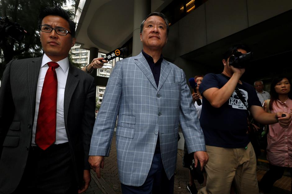 Former HK commodities exchange chief charged with conspiracy to defraud regulator