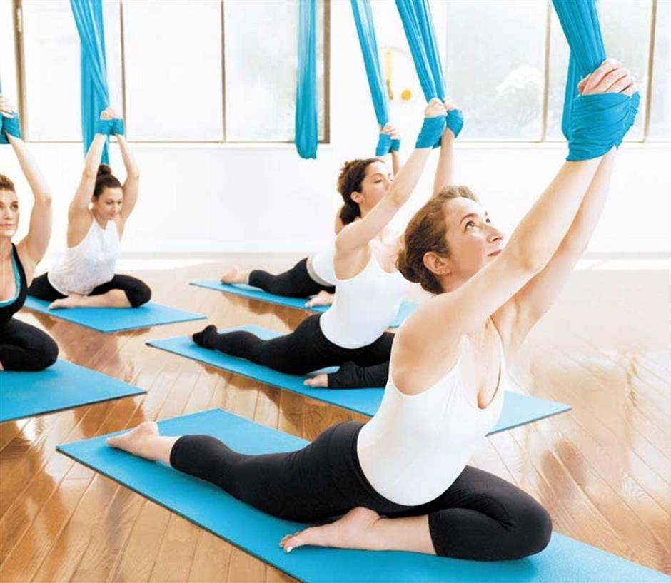 Aerial exercise routines take yoga classes to new heights