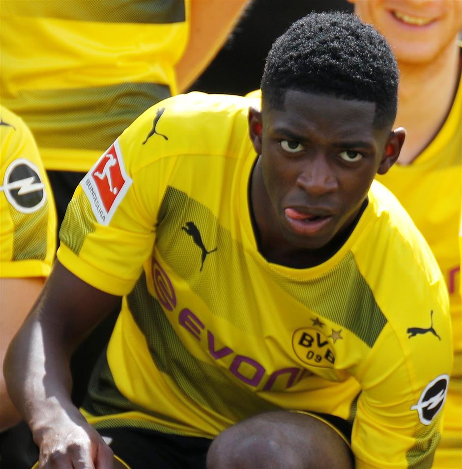 Dortmund's Dembele remains suspended over missed training