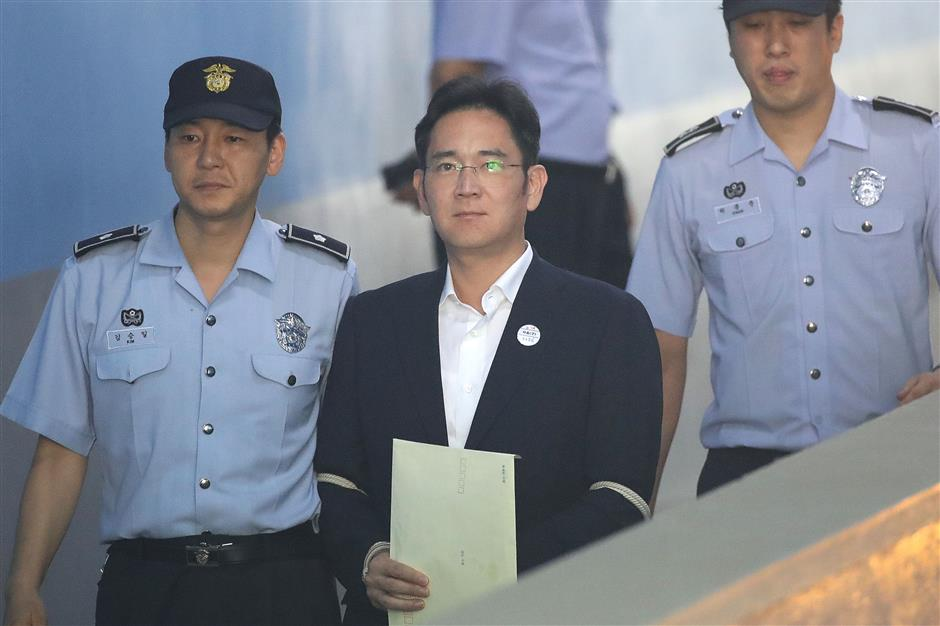Samsung heir sentenced to 5 years in prison for bribery, other crimes