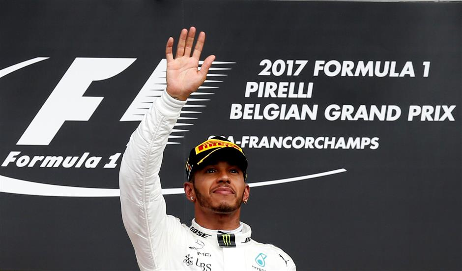 Hamilton marks 200th race with Spa success
