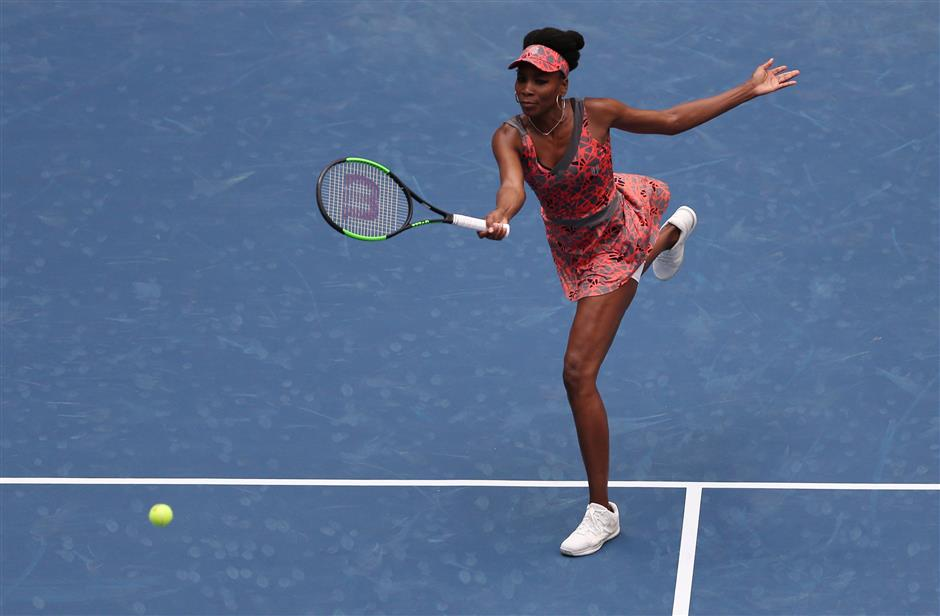 Venus celebrates 20 years at US Open, awaits Serena return