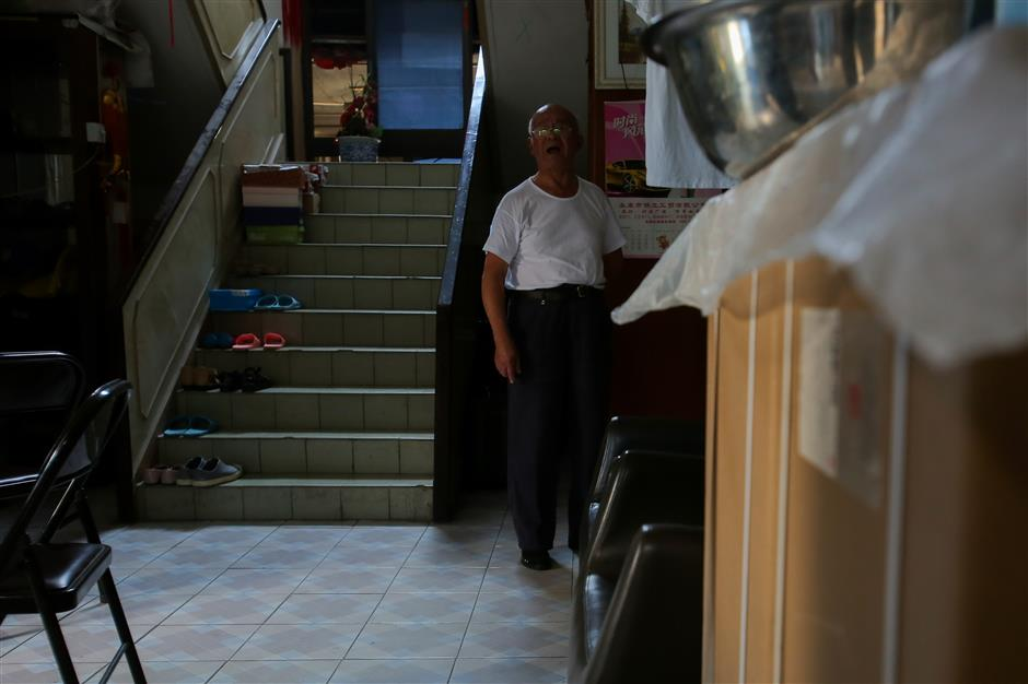 Nail house residents moving after six years: we're tired