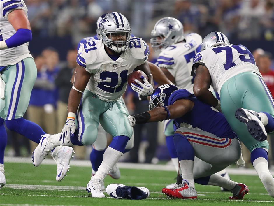 Cowboys' Elliott shines on the field despite threat of suspension