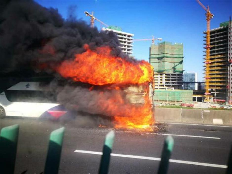 Tourist bus carrying 57 bursts into flames, no one injured