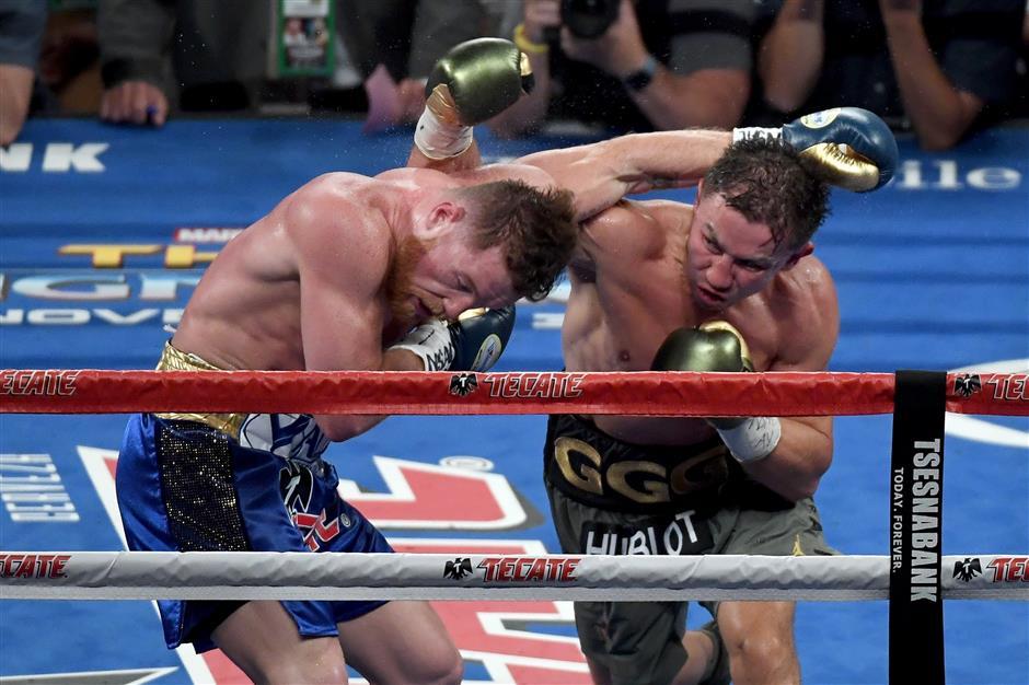 Golovkin, Alvarez fight to a brutal draw; rematch to come