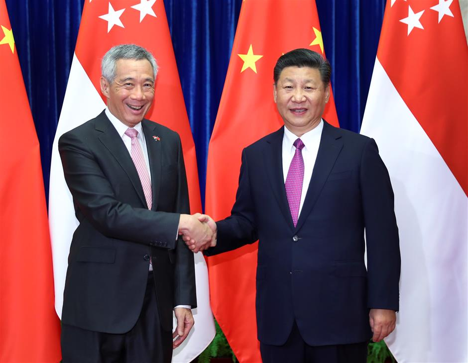 Xi meets Singaporean PM on advancing ties