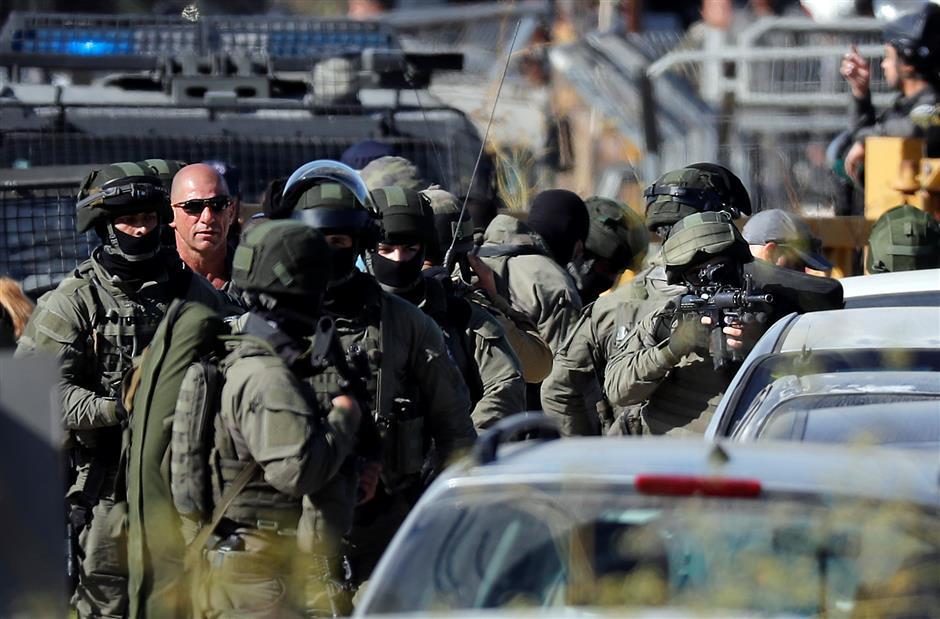 Palestinian gunman kills 3 Israelis at settlement