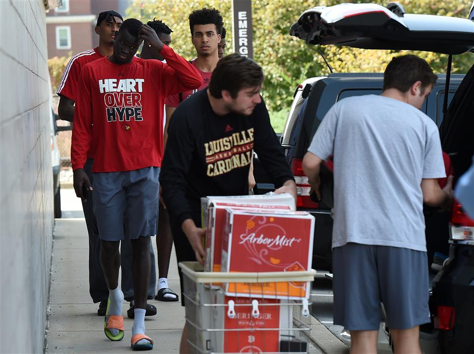 Louisville basketball coach Pitino put on leave amid bribery scandal