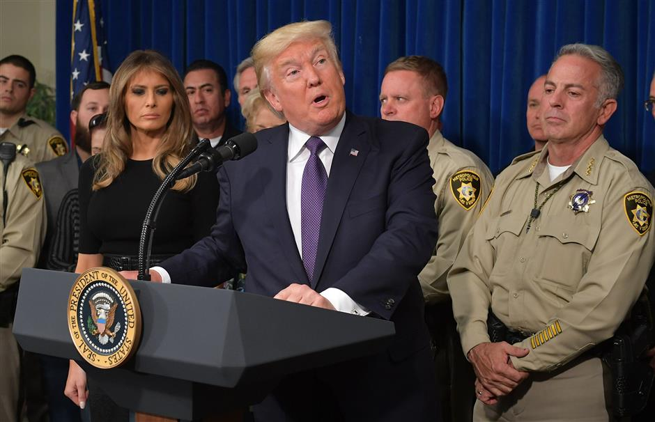 Trump visits Las Vegas after mass shooting, avoids gun control talk