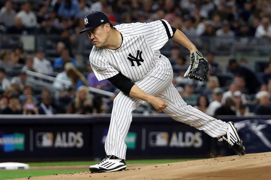 Judge's grab; Tanaka, Bird lift Yanks in Game 3