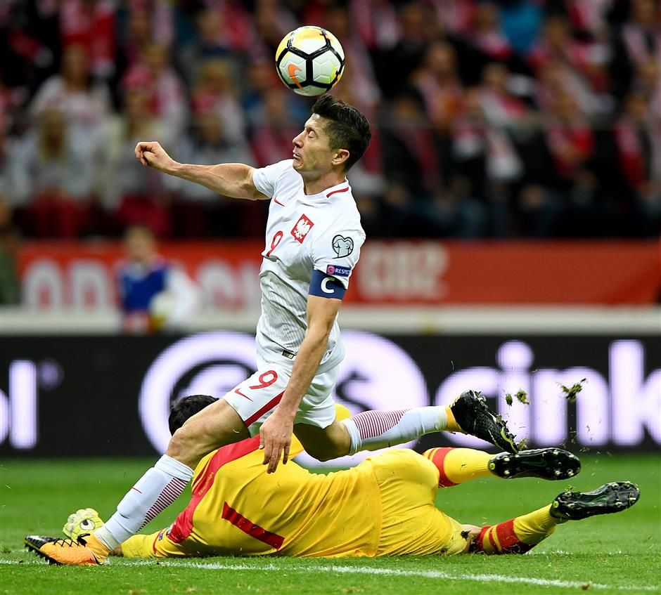 Poland heads to WCup, perfection for Germany