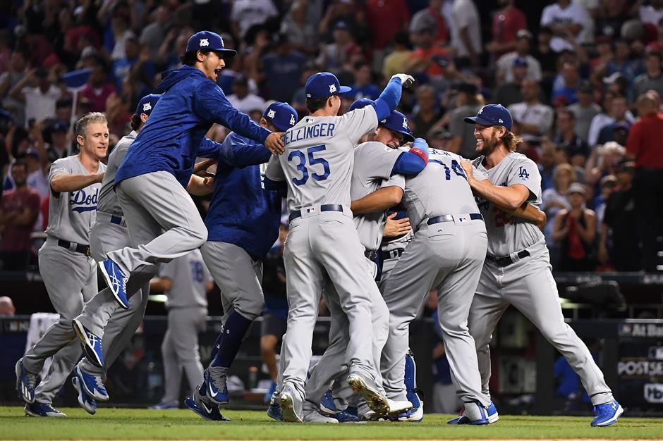 Astros, Dodgers advance in MLB playoffs