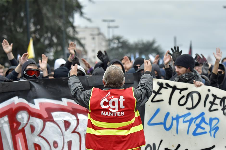 Striking French workers disrupt flights and schools