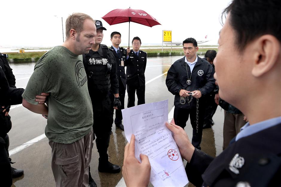 US child sex suspect handed over at Pudong