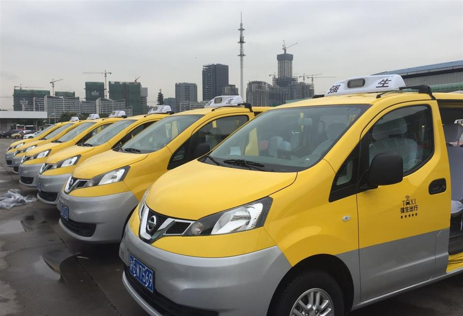 Lucky yellow minivan taxis falling short on supply