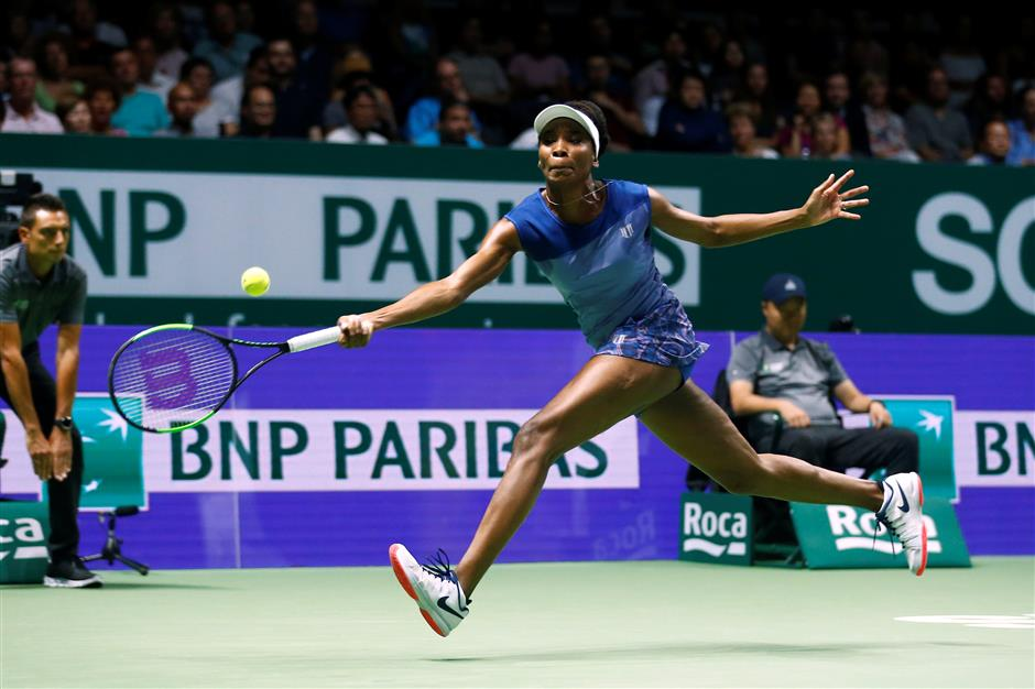 Venus stuns Muguruza to make last four at WTA Finals in Singapore