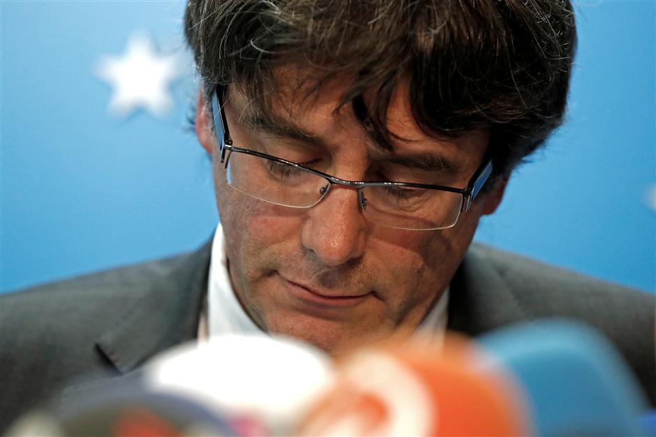 Sacked Catalonia leader turns self in