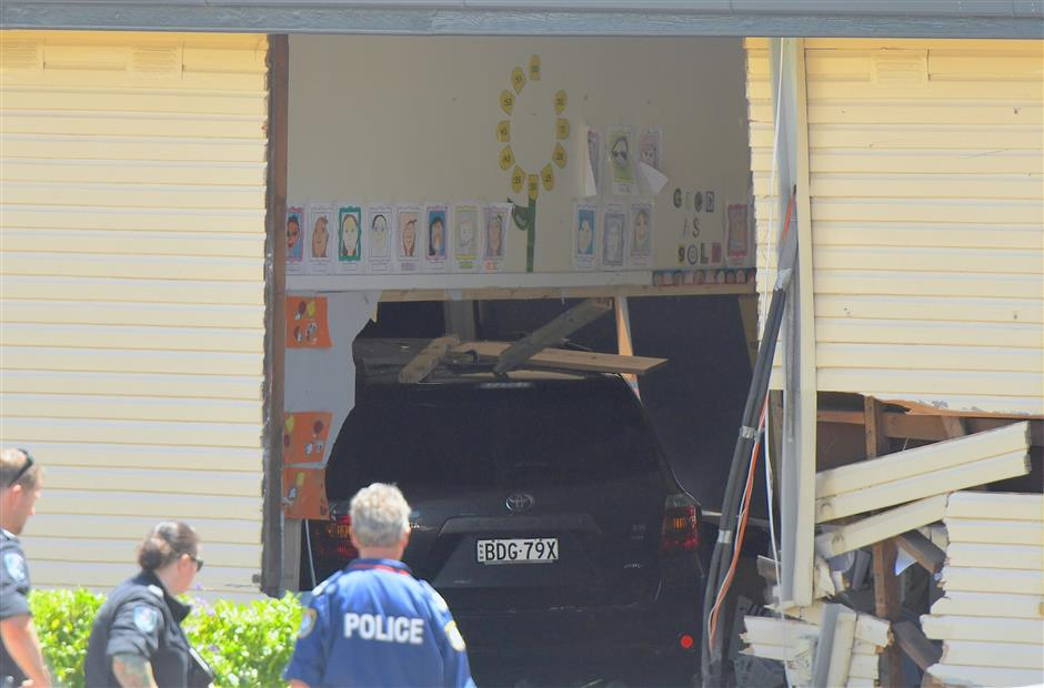 2 boys die after car plows into school