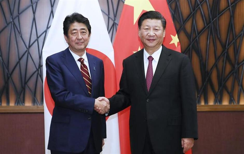 Xi urges Abe to take more practical actions to improve China-Japan ties