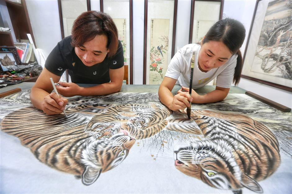 Man's lucky break with tiger painting helps village roar to life