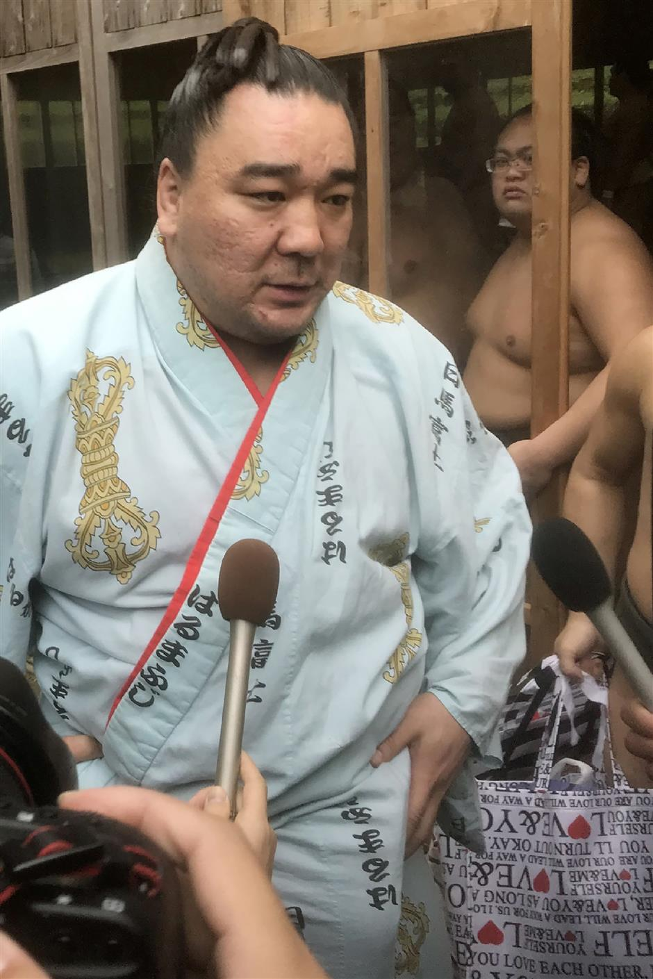 Sumo champ investigated over alleged assault