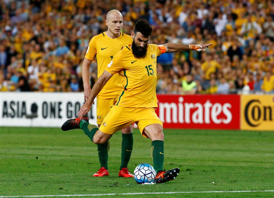 Jedinak hat-trick sends Australia to World Cup