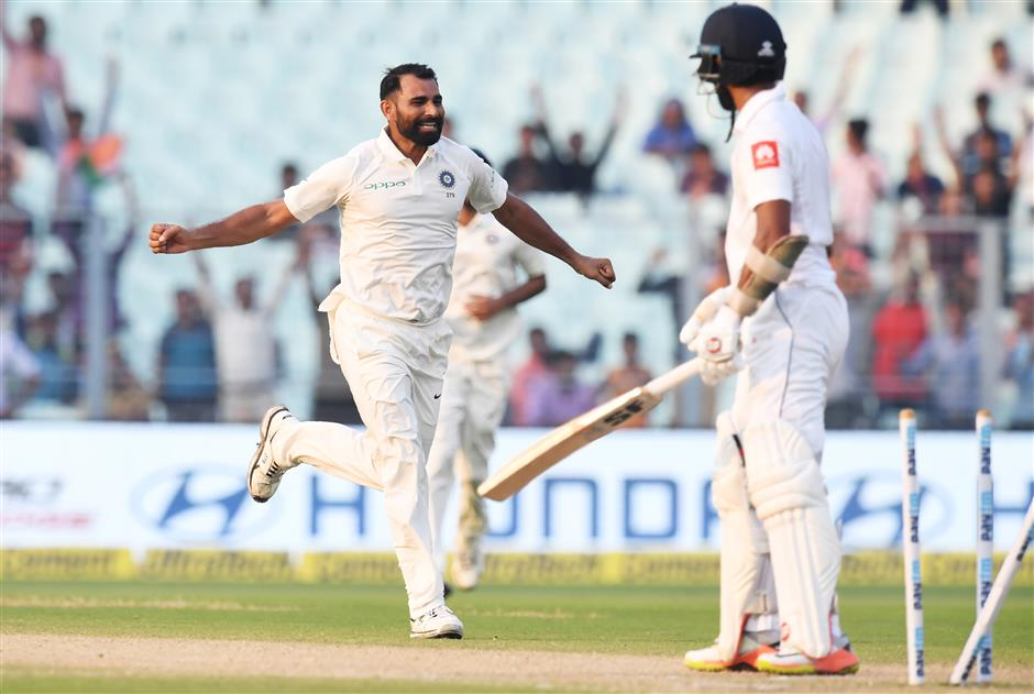 Kohli hits 50th century as Sri Lanka clings on for draw in first test