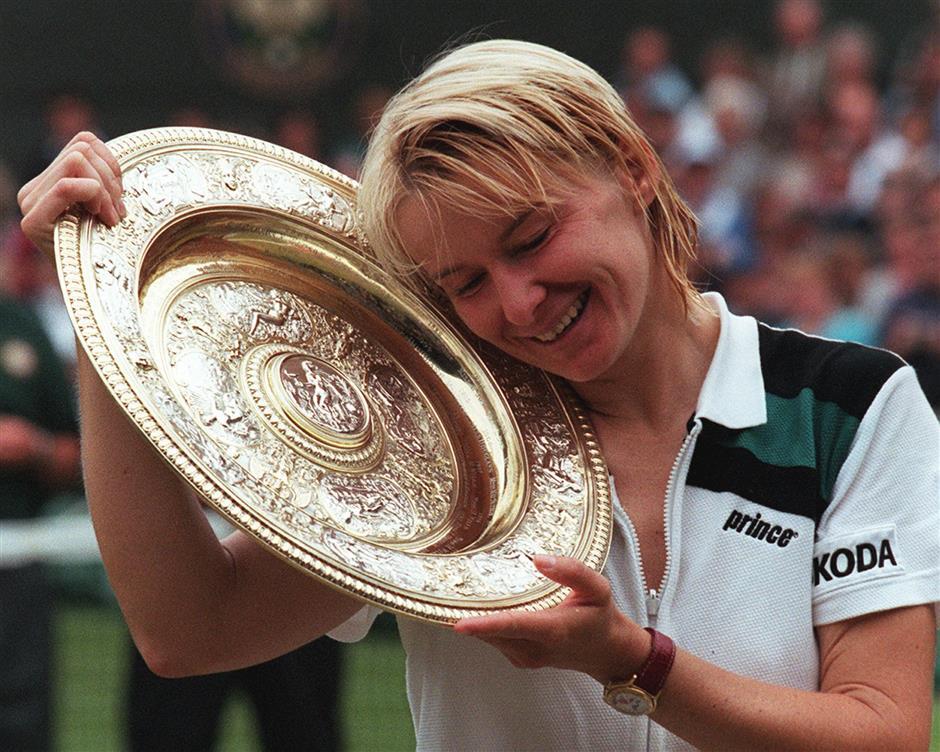 Former Wimbledon champ Novotna dies at 49
