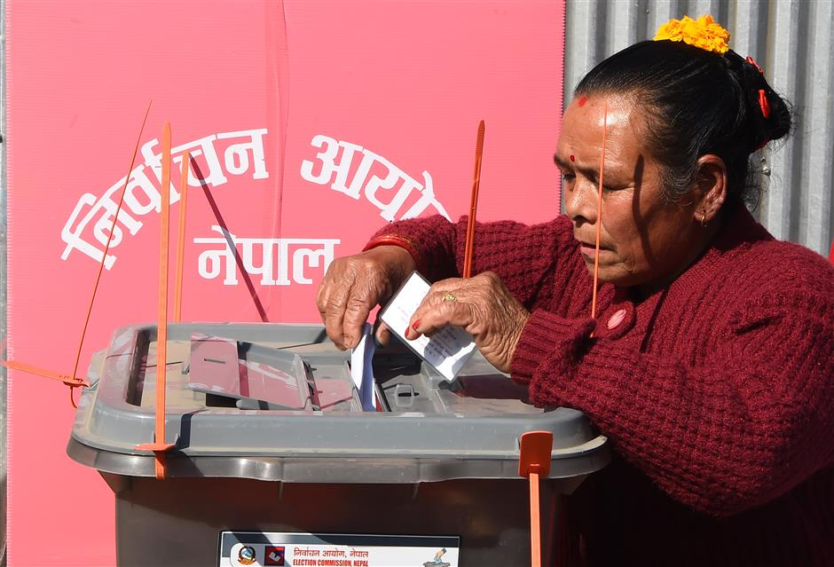 Nepalis vote in historic election as new charter reforms government