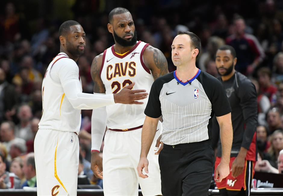 Streaking Cavs survive James' first career ejection to douse Heat