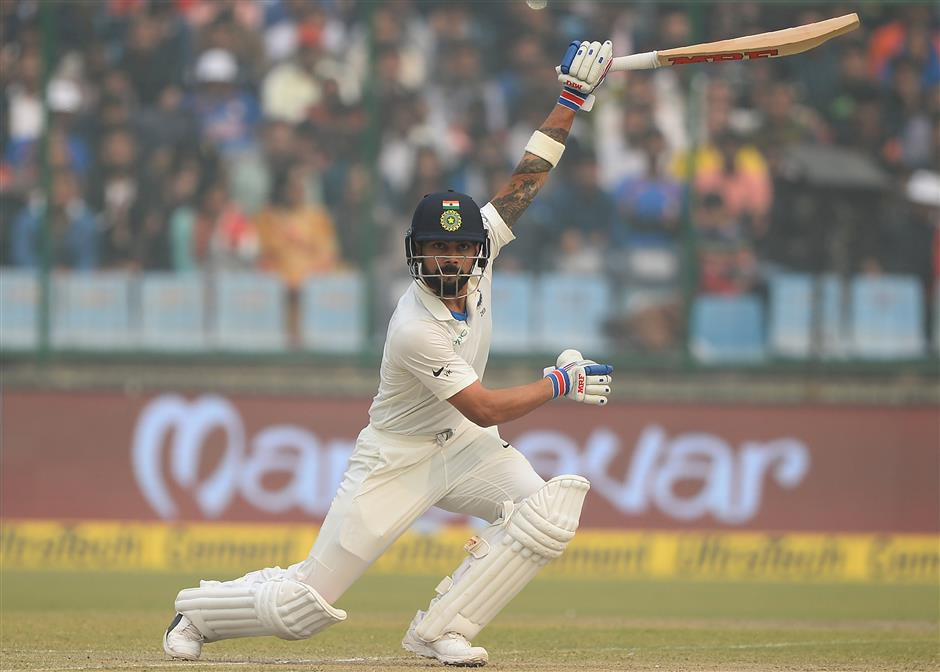 Kohli's 243 fuels India's charge at smog-hit Delhi