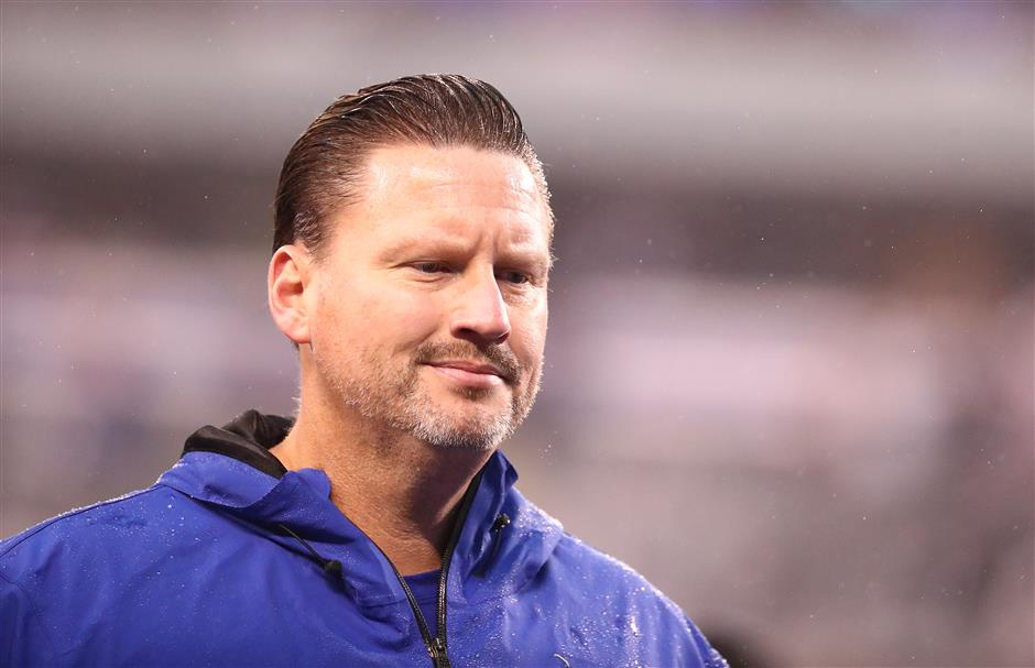 Reeling Giants fire coach McAdoo, GM Reese