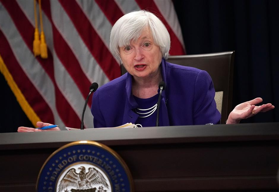US Fed raises interest rate, forecasts 3 hikes in 2018