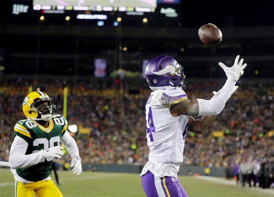 Ravens edge closer to playoff berth; Vikings shut out Packers