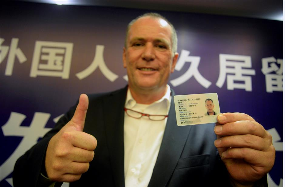 China issues 4,819 new version permanent residence cards to foreigners