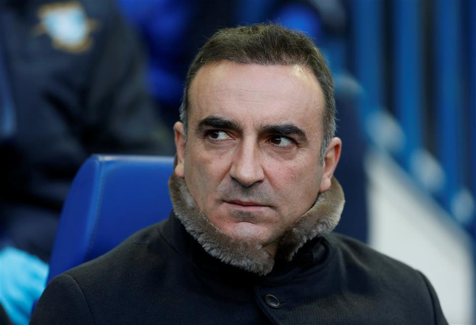 Swansea hires Carvalhal as 5th coach in 2 years